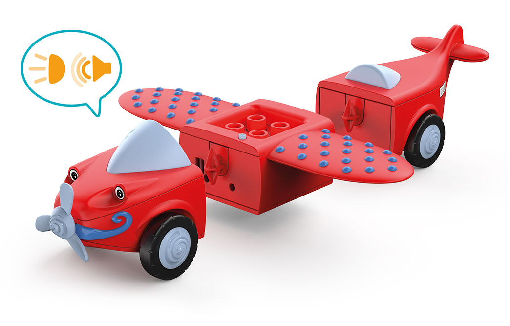 Disassembled Toddys toy plane Leo Loopy in red with white wheels and propellers, blue dots on the wings and sound speech bubble