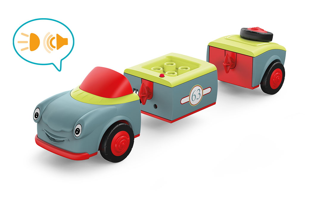 Disassembled Toddys toy vehicle Olli Oldy in the colors gray-red-green with red wheels and green seats