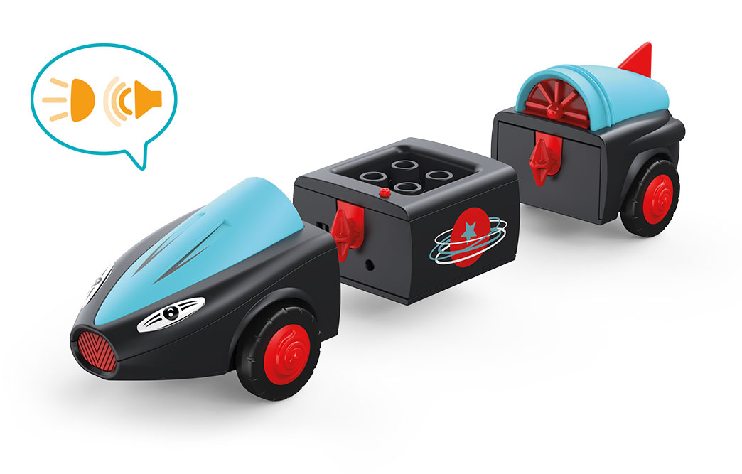 Disassembled Toddys toy vehicle Sam Speedy in rocket form in the colors black and blue with red wheels and sound speech bubble